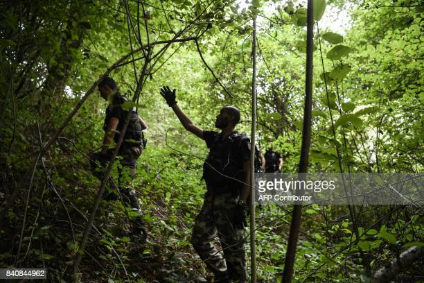 French gendarmes search through a forest in PontdeBeauvoisin on August 30 2017 after the disappearance of a 9yearold girl Police reinforcements...