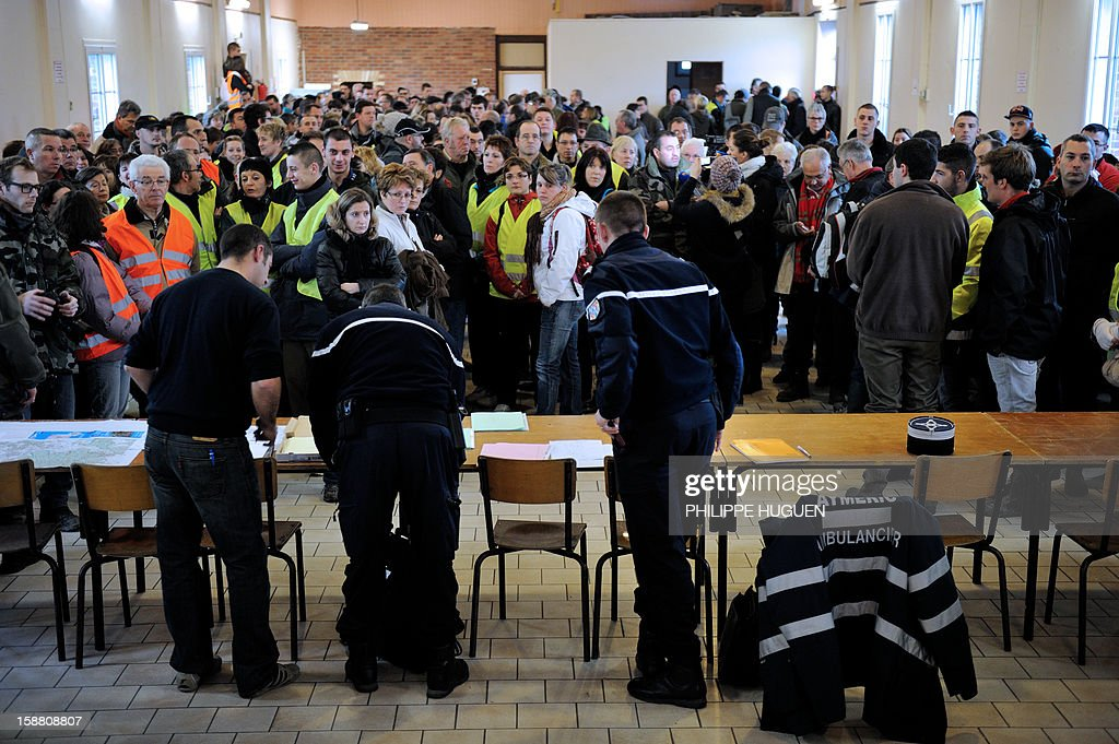 French Gendarmes speak to volunteers before to take part in searches on December 30, 2012 in Pimprez to find Bruno, a young trisomic man reported missing since December 18.