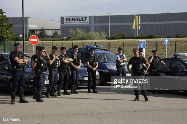 French gendarmes stand by as employees of French auto parts manufacturer GMS threatened with liquidation block the site of their supplier Renault on...