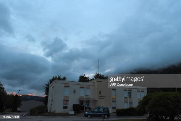 French gendarmes stand guard at the Gendarmerie in SaintEtienneLesRemiremont eastern France on June 28 where Murielle Bolle has been placed in...