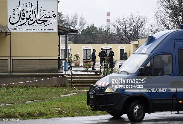 French gendarmes stand guard in front of the mosque of Valence southeastern France on January 2 a day after a driver was shot and wounded as he drove...