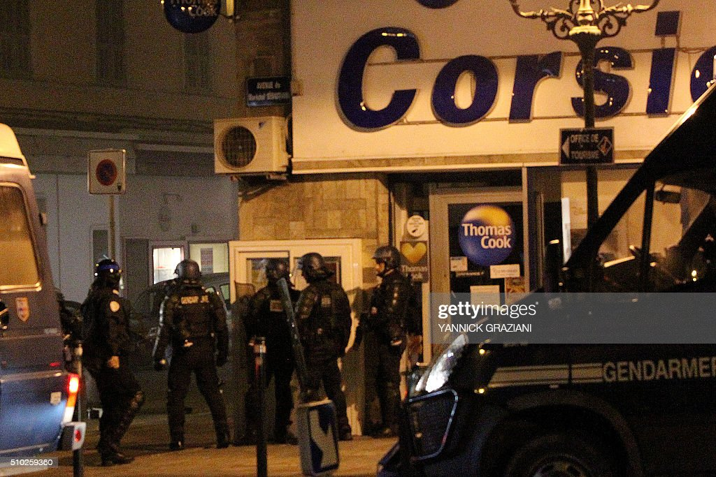 French gendarmes stand guard on February 14, 2016, in Bastia, on the French Mediterranean island of Corsica, after incidents broke out during a gathering in support of a Sporting Club de Bastia supporter who was injured the previous night in Reims in clashes with police in the city centre following a French L1 football match between Reims and Bastia. / AFP / YANNICK GRAZIANI