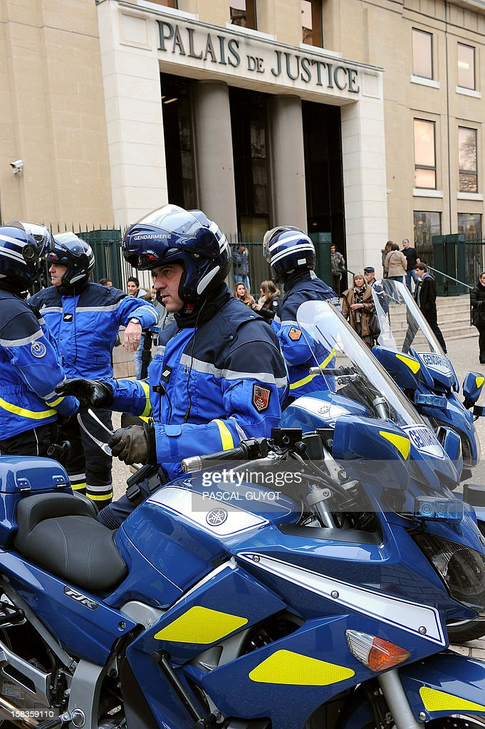 French gendarmes stand guard outside the Nimes courthouse before the arrival for a hearing of Kamel Bousselat, the presumed abductor of Chloe, a 15-year-old girl who was found alive in Germany after being reported missing for a week, on December 14, 2012 in Nimes, southern France.