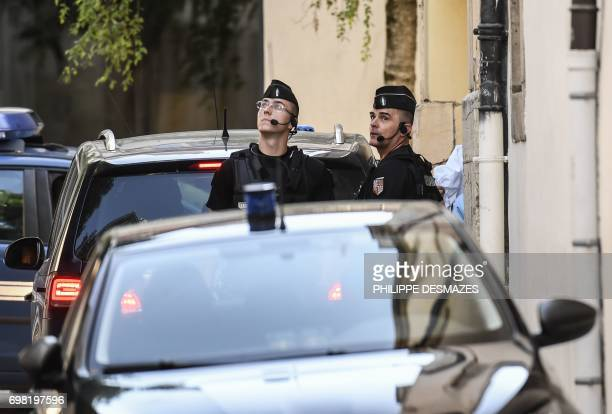 French gendarmes stand guard while Marcel Jacob and his wife Jacqueline arrive aboard police vehicles for a hearing at the courthouse of Dijon on...