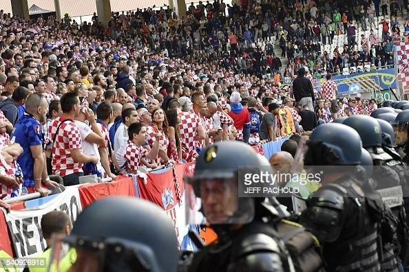 French gendarmes stand in front of Croatia supporters after flares were thrown during the Euro 2016 group D football match between Czech Republic and...