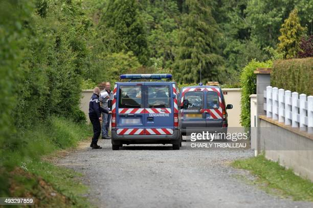 French Gendarmes stand in front of the alleged killer's house in BrettevilleleRabet northwestern France where the mayor aged 55 was found dead after...