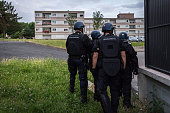 French Gendarmes stand in Persan on July 21 2016 after a second night of violence in a row with 15 cars set ablaze by residents furious over the...