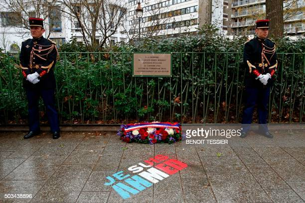 TOPSHOT French gendarmes stand near a commemorative plaque on January 5 2016 during a ceremony at the site where policeman Ahmed Merabet was killed...