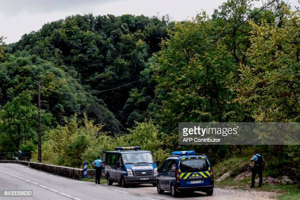 French Gendarmes stand next to the Guiers river as they search for Maelys a missing nineyearold girl in Les Gorges de Chailles on September 6 2017 in...