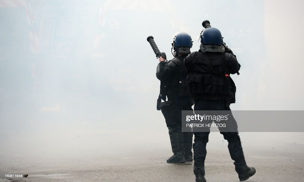 French Gendarmes who cordon off the area of the European Parliament in Strasbourg, eastern France, hold teargas launchers, on February 6, 2013, during a demonstration of workers from several European Arcelormittal steel plants. The world's top steel producer ArcelorMittal stumbled into the red last year with a net loss of $3.72 billion (2.75 billion euros) largely due to costs related to Europe.