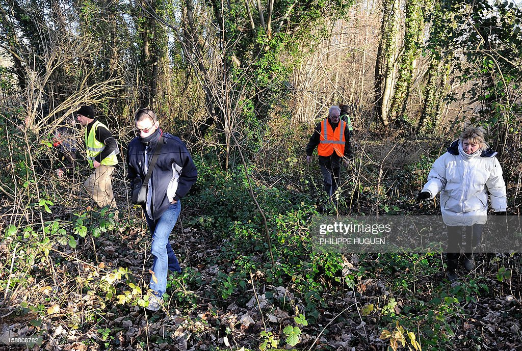 French Gendarmes with the help of volunteers take part in searches on December 30, 2012 in Pimprez to find Bruno, a young trisomic man reported missing since December 18.