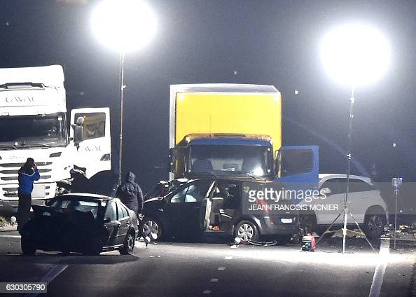 French gendarmes work at night at the site of a car accident involving around fifty vehicles which killed 5 people and injured 20 on the departmental...