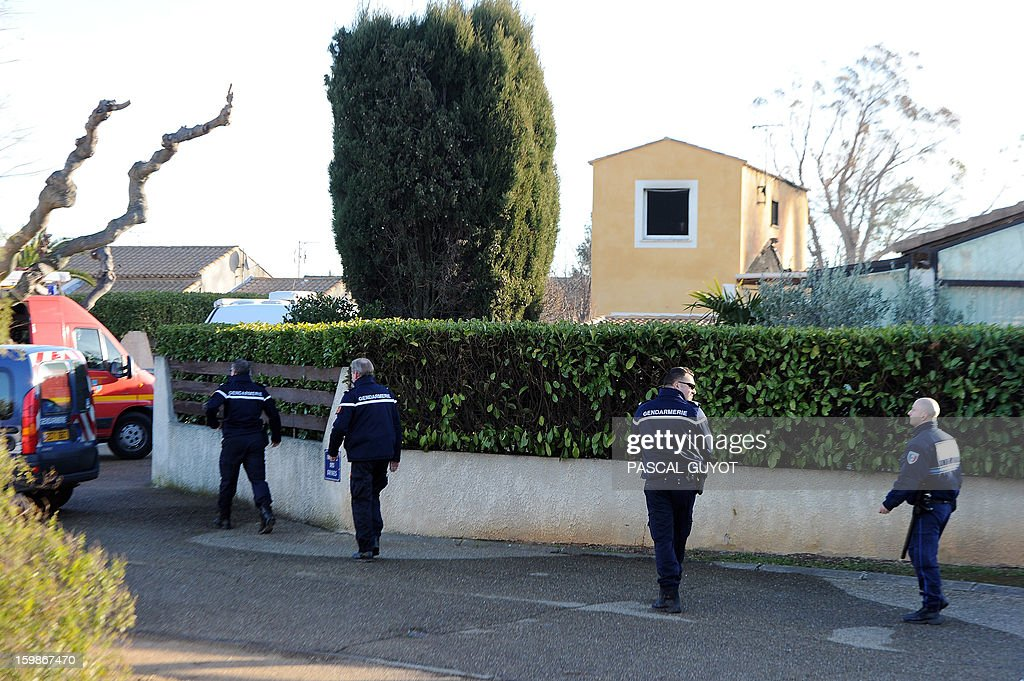 French Gendarmes work outside a house where five people were found dead on January 22, 2013 in Garons, near Nimes, southern France. The bodies of two adults and three children were found by firemen after a neigbour called for a fire in the afternoon. AFP PHOTO / PASCAL GUYOT