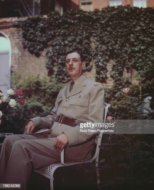 French general and Leader of the Free French forces Charles de Gaulle pictured wearing military uniform as he sits in a garden chair in London circa...