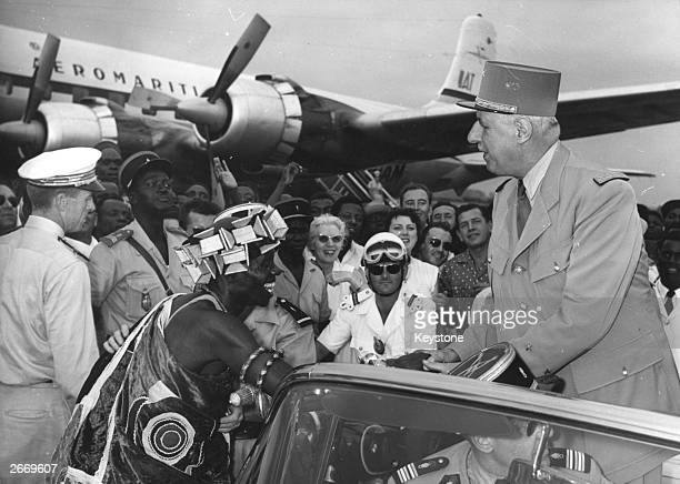 French General and politician Charles De Gaulle is greeted by a crowd on his arrival at Abidjan in the Ivory Coast