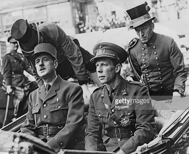 French General Charles de Gaulle and Prince Charles of Belgium are cheered as they ride in the State Coach through the streets of Brussels 12th...