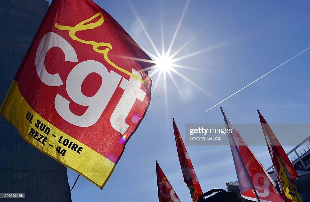French General Confederation of Labour (CGT) union flags are pictured during the traditional May Day rally in Nantes, western France, on May 1, 2016. / AFP / LOIC