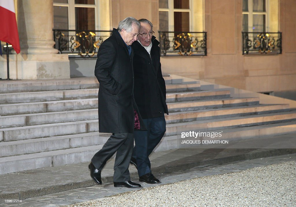 French General Confederation of Small and Medium Sized Entreprises (CGPME) union President Jean-François Roubaud (L) speaks with former French head of French employers association Medef Yvon Gattaz (R) as they leave the Elysee Palace in Paris, on January 17, 2013, after a New Year wishes ceremony to union representatives and businessmen, at the Elysee presidential Palace in Paris.