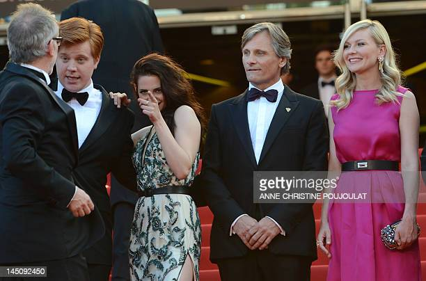 French general delegate of the Cannes Film Festival Thierry Fremaux welcomes British actor Danny Morgan US actress Kristen Stewart US actor Viggo...
