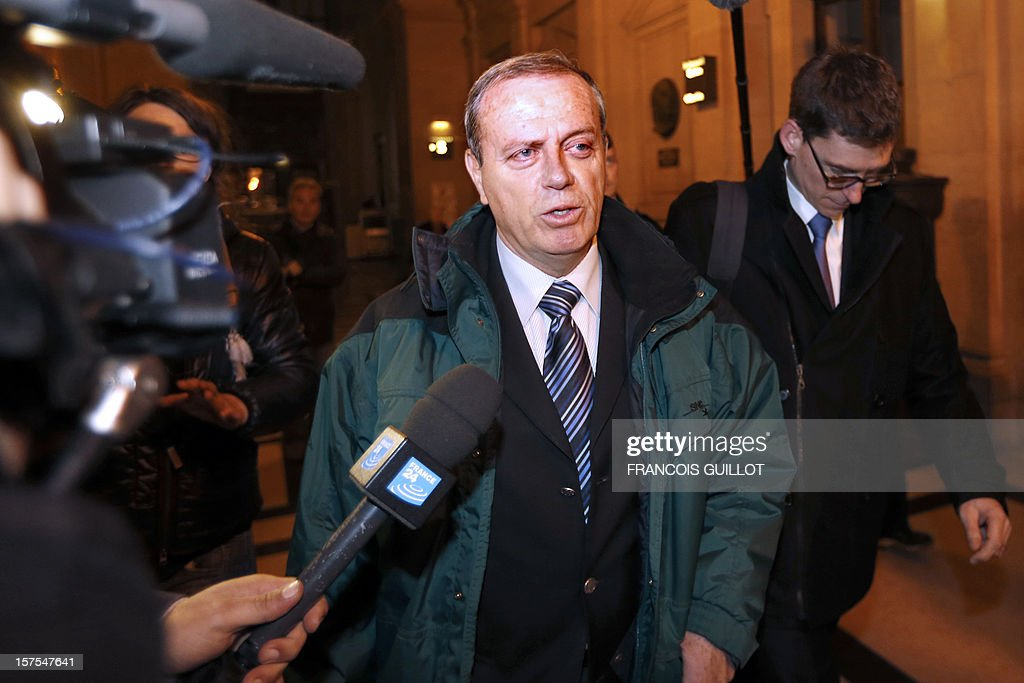 French General Henri Poncet walks in court in Paris on December 4, 2012 during the trial of four French former soldiers, including a colonel, for killing a man in Ivory Coast in 2005 during a peacekeeping mission in the west African country. The accused say they acted under orders to kill Firmin Mahe, who was suffocated to death while travelling in a French military vehicle. Mahe's death on May 13, 2005, led to the sacking of General Henri Poncet, who was in command of the 4,000-strong peacekeeping mission. AFP PHOTO / Francois GUILLOT