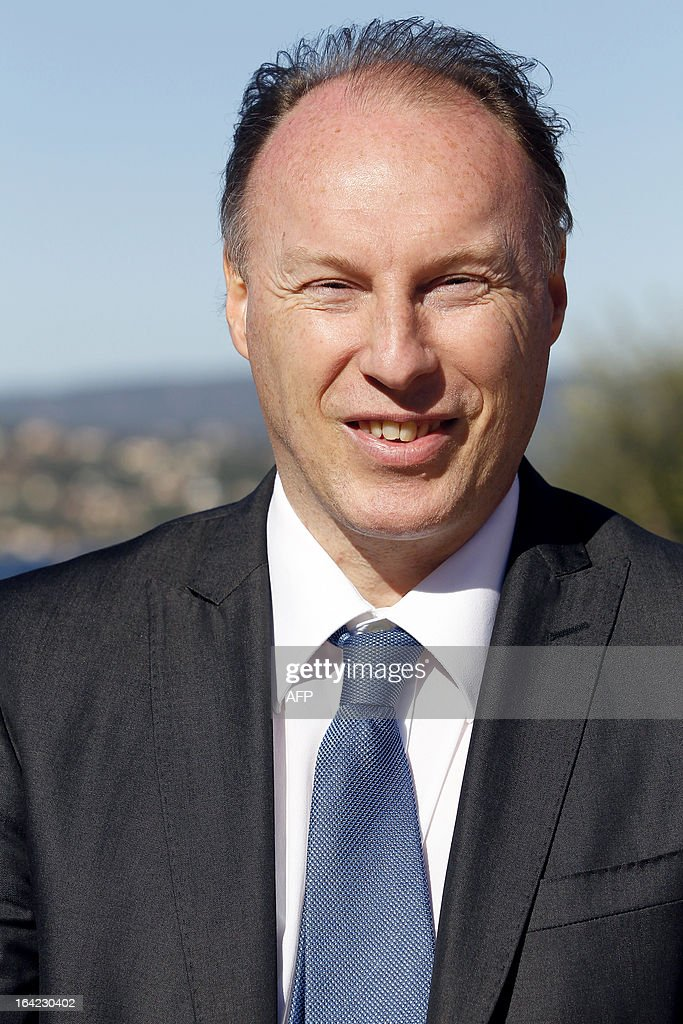 French Gilles Queneherve, former champion in athletics, in charge of communication with Corsican prefects for the 2013 Tour de France cycling race, poses, on March 21, 2013 in Porto-Vecchio, on the French Mediterranean island of Corsica, during an event to uncloak the countdown board 100 days ahead of the race which will start from Porto-Vecchio. AFP PHOTO / PASCAL POCHARD-CASABIANCA