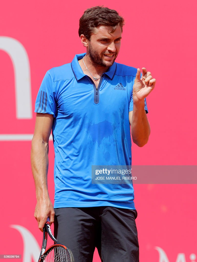 French Gilles Simon gestures after missing point against Spanish Pablo Carreno Busta during their quarter-final match of the Estoril Open Tennis tournament in Estoril on April 29, 2016. / AFP / JOSE