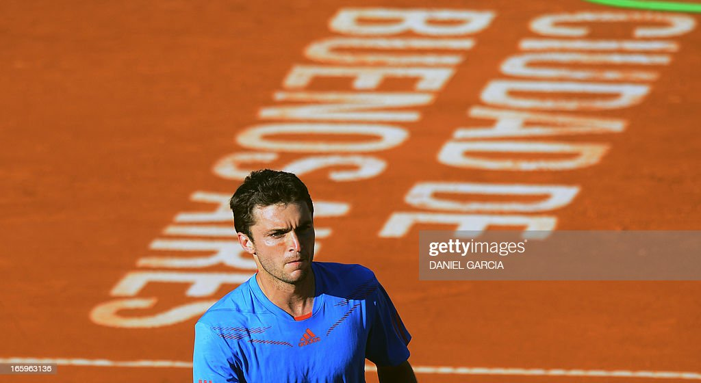 French Gilles Simon walks to the bench during the 2013 Davis Cup World Group quarterfinal single tennis match against Argentine Carlos Berlocc at Parque Roca stadium in Buenos Aires on April 7, 2013. Argentina won by 3-2 and will play in semifinals with the Czech Republic.