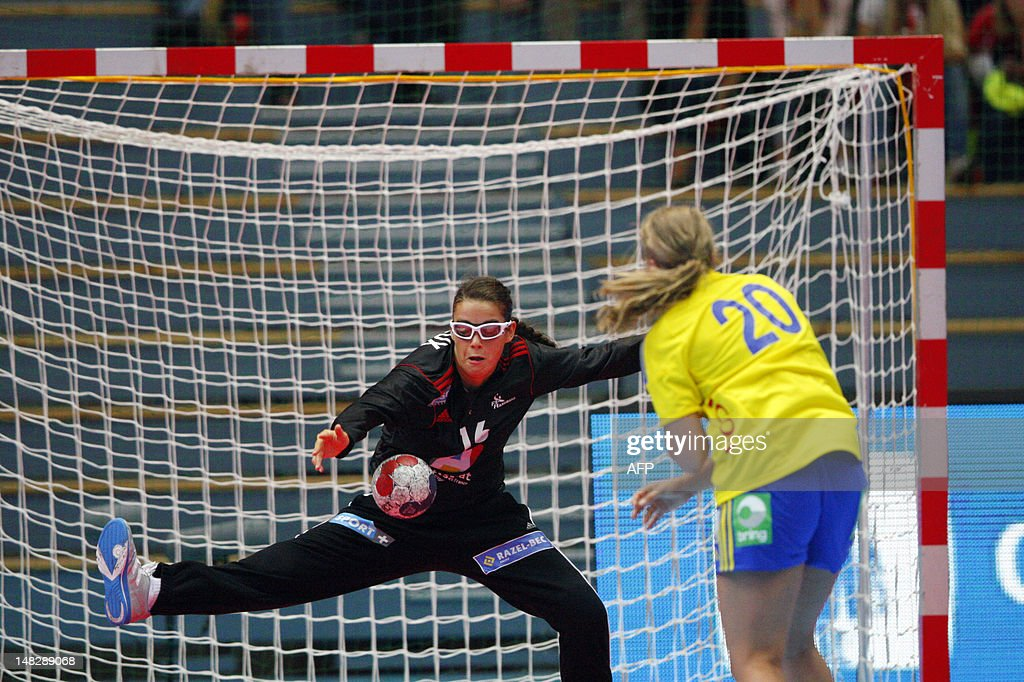 French goalkeeper Cleopatre Darleux stops an attack from Sweden's Isabelle Gulldén during the Scandinavian Open handball tournament match between Sweden and France, in Drammen, on July 13, 2012, ahead of the 2012 London Olympics. AFP PHOTO / SCANPIX NORWAY / Audun Braastad