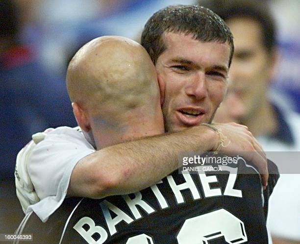 French goalkeeper Fabien Barthez and Zinedine Zidane celebrate 12 July at the Stade de France in SaintDenis near Paris after France defeated Brazil...