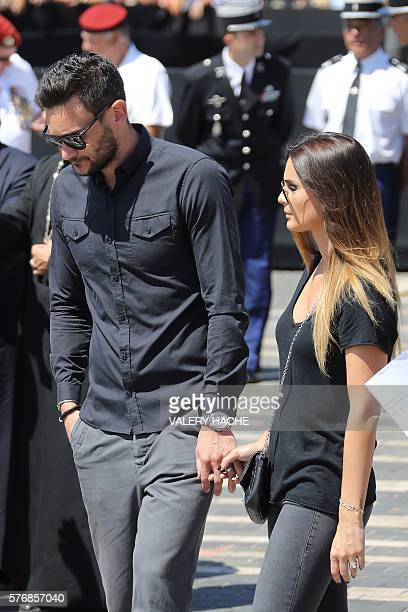 French goalkeeper Hugo Lloris and his wife Marine arrive on the Promenade des Anglais in Nice to observe a minute of silence on July 18 in tribute to...