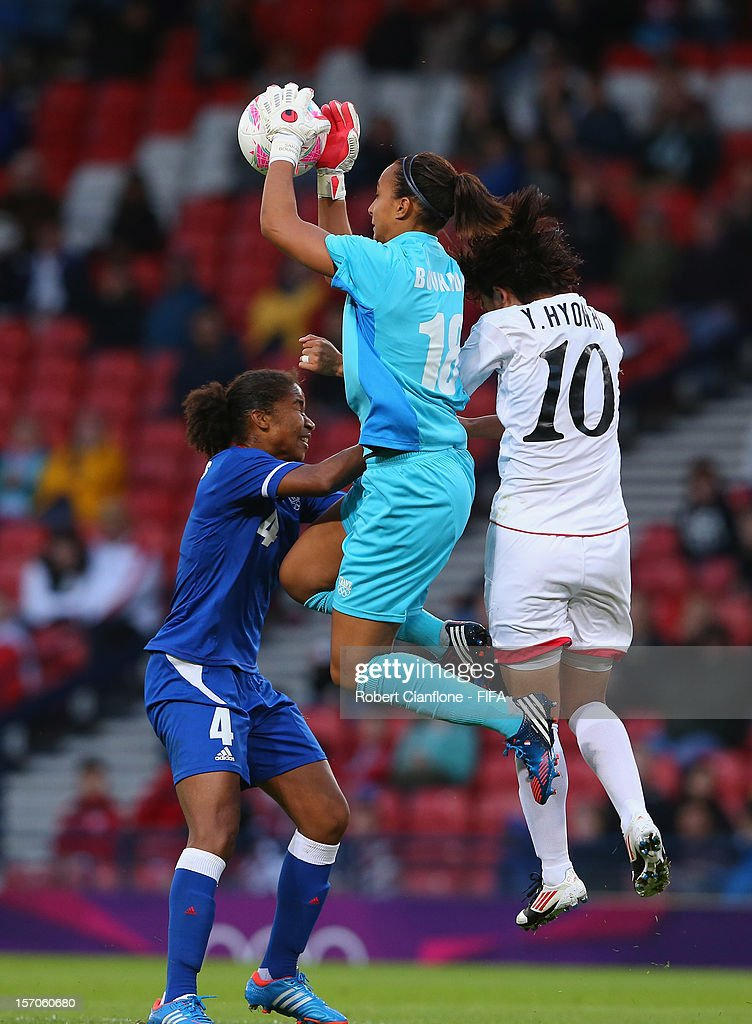 French goalkeeper <a gi-track='captionPersonalityLinkClicked' href=/galleries/search?phrase=Sarah+Bouhaddi&family=editorial&specificpeople=2351270 ng-click='$event.stopPropagation()'>Sarah Bouhaddi</a> takes the ball during the Women's Football first round Group G Match of the London 2012 Olympic Games between France and Korea DPR at Hampden Park on July 28, 2012 in Glasgow, Scotland.