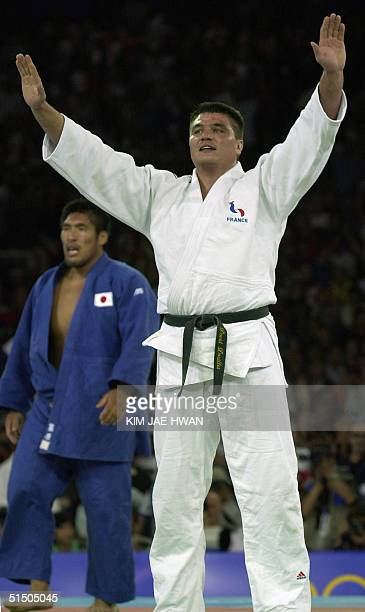 French gold medal judo winner David Douillet jubilates after defeating Shinichi Shinohara of Japan in the Judo heavyweight 100 kg finals at the...