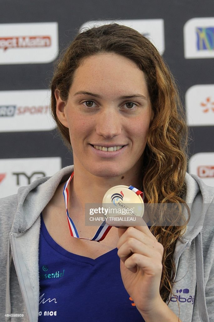 French gold medallist <a gi-track='captionPersonalityLinkClicked' href=/galleries/search?phrase=Camille+Muffat&family=editorial&specificpeople=596271 ng-click='$event.stopPropagation()'>Camille Muffat</a> poses on the podium after the women's 400m freestyle final heat of the French swimming championships in Chartres on April 13, 2014. AFP PHOTO / CHARLY TRIBALLEAU