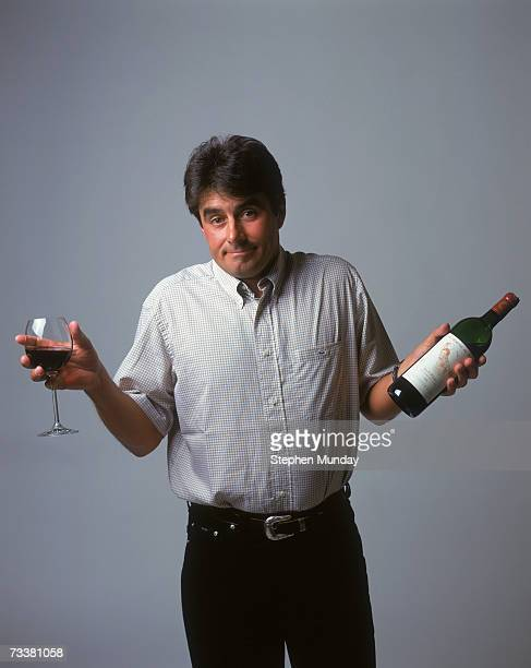 French golfer Jean Van de Velde poses with a bottle of his own label HautMedoc red wine 'La Reserve de Jean' May 2000