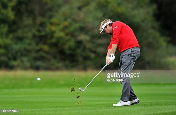 French golfer Victor Dubuisson plays his approach shot to the 13th green in his match against Spanish golfer Pablo Larrazabal during the first day of...