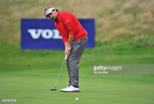 French golfer Victor Dubuisson putts on the 16th green in his match against Spanish golfer Pablo Larrazabal during the first day of the group stage...