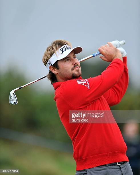 French golfer Victor Dubuisson watches his drive to the 14th green in his match against Spanish golfer Pablo Larrazabal during the first day of the...