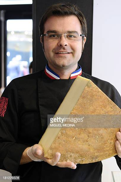 French gourmet food company Fauchon's cheese seller Francois Robin presents an Appellation d'origine protegee Beaufort cheese at a shop of Fauchon on...