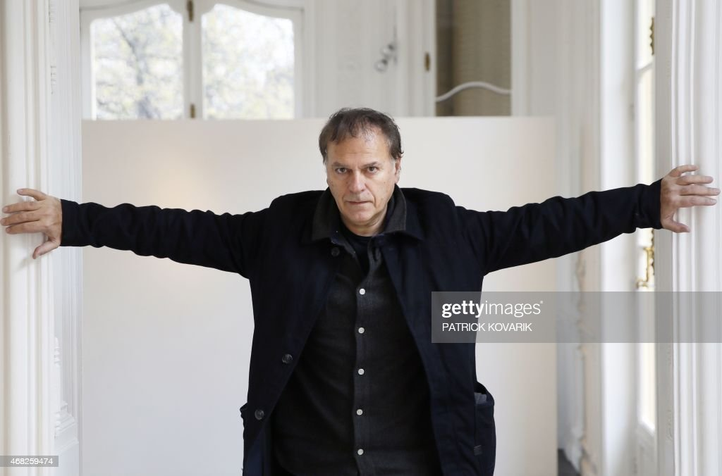 French graphic novel author <a gi-track='captionPersonalityLinkClicked' href=/galleries/search?phrase=Enki+Bilal&family=editorial&specificpeople=2090909 ng-click='$event.stopPropagation()'>Enki Bilal</a> poses on April 1, 2015 in Paris. AFP PHOTO / PATRICK KOVARIK