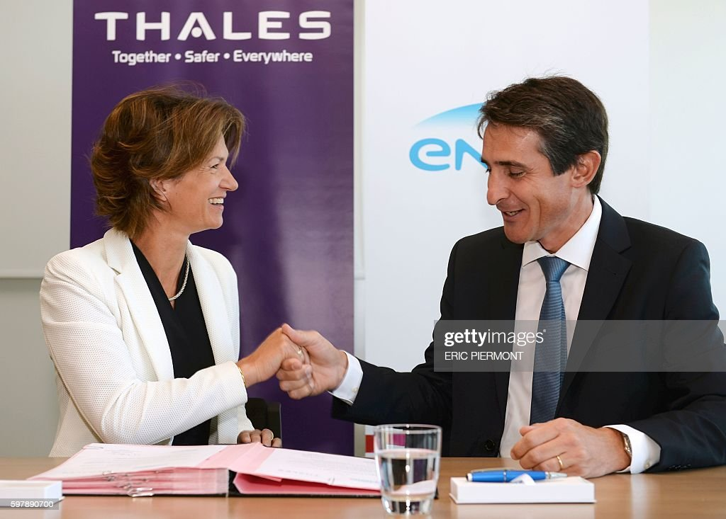 French group Engie Chief Executive Isabelle Kocher and Thales group CEO Patrice Caine attend the signing of a partnership between the two groups...