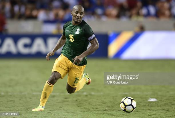 French Guiana's midfielder Florent Malouda runs with the ball during the second half of the Honduras vs French Guiana 2017 CONCACAF Gold Cup match at...
