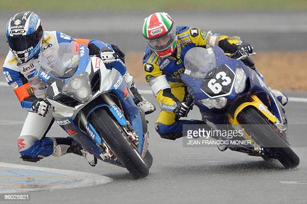 French Guillaume Dietrich rides his Suzuki GSXR 1000 N°1 ahead of his compatriot Hugo Marchand on his Honda N° 63 during the 32nd edition of the Le...