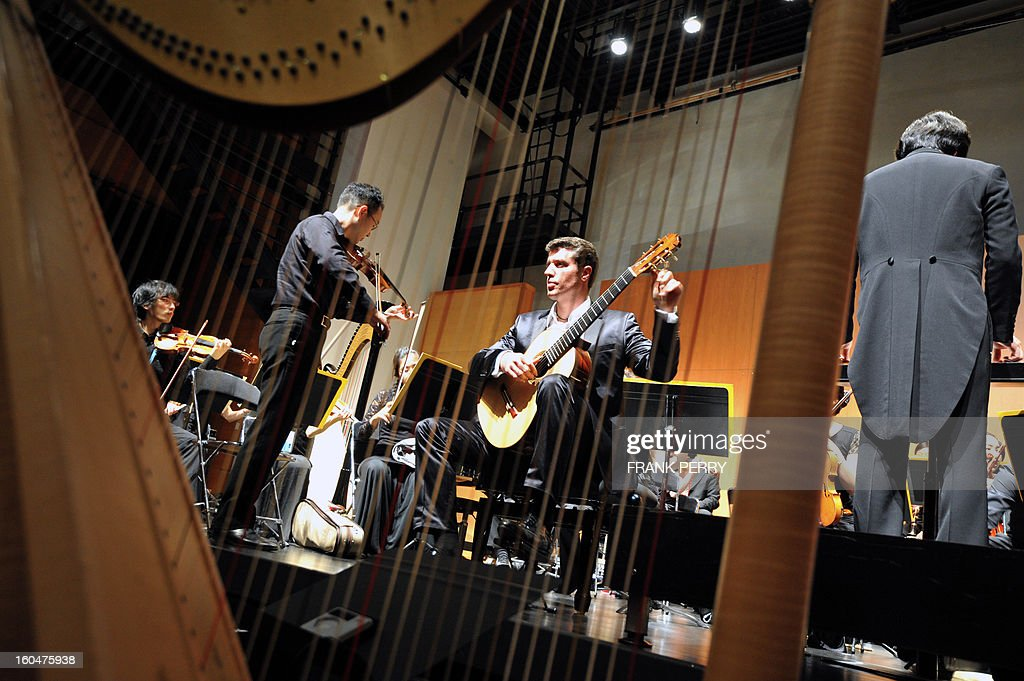 French guitarist Emmanuel Rossfelder gets ready prior to a concert with Yokohama Sinfonietta under the direction of Yazuki Yamada as part of the 'Folle Journee' classic music festival on February 1, 2013 in Nantes. The 19th edition of this festival will run until next February 3.