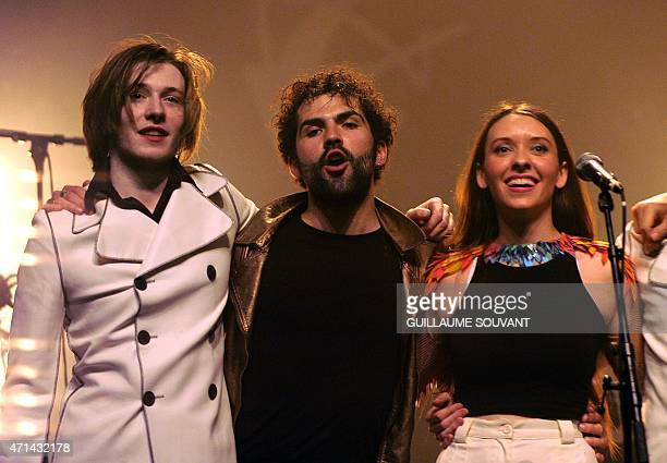 French guitarists Raoul Chichin and Joseph Delmas French singer Simone Ringer of the band 'Minuit' wave on stage as part of the 39th edition of 'Le...