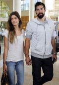 French handball player Nicola Karabatic and his girlfriend Géraldine Pillet leave the Montpellier courthouse on June 10 after a hearing before a...
