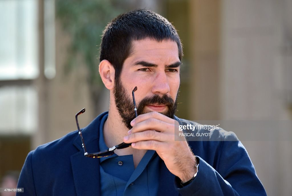 French handball player Nikola Karabatic arrives at Montpellier's courthouse southern France on June 25 prior to a hearing of his trial along with 16...