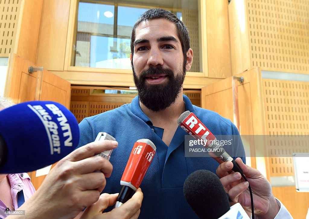French handball player Nikola Karabatic speaks to journalists at Montpellier's courthouse southern France on June 25 prior to a hearing of his trial...