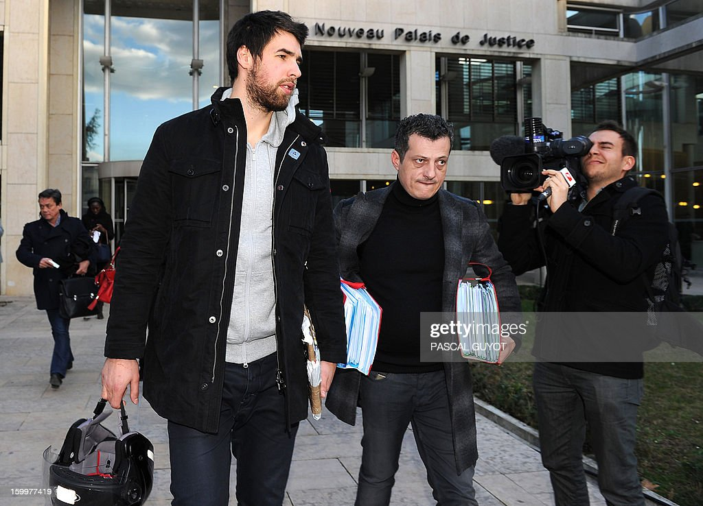 French handball team of Montpellier Aix en Provence Luka Karabatic (L), suspected of match-fixing and illegal betting, leaves with his lawyer, Michael Cordier (C) after attending a hearing at the courthouse in Montpellier, southern France, on January 24, 2012. Nikola and Luka Karabatic and their partners, plus a number of other players and others implicated in the affair, were placed under formal investigation in October 2012 on suspicion of defrauding Francaise des Jeux. AFP PHOTO / PASCAL GUYOT