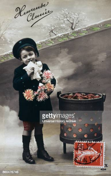 French Happy New Year postcard depicting a boy with flowers standing near a hot brazier 1900