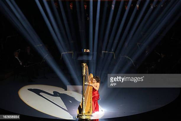 French harpist Emilie Gastaud performs during the Victoires de la Musique Classique ceremony on February 25 2013 in the French southwestern city of...